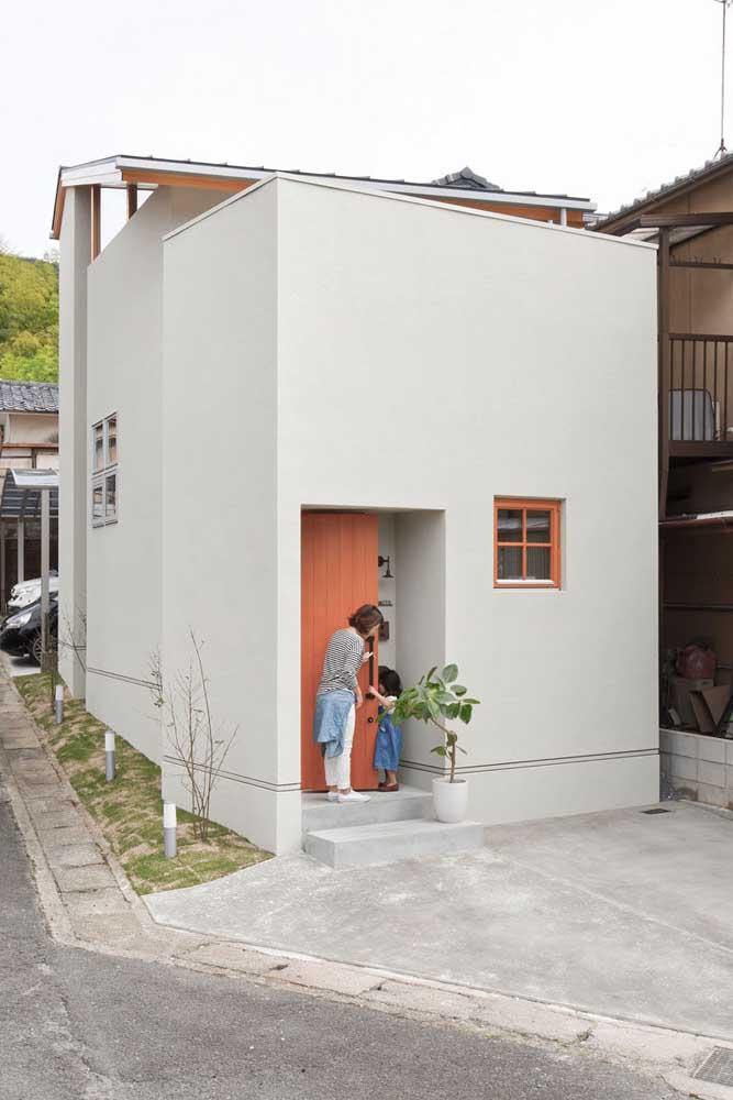 Fachada de uma casa simples, pequena e popular