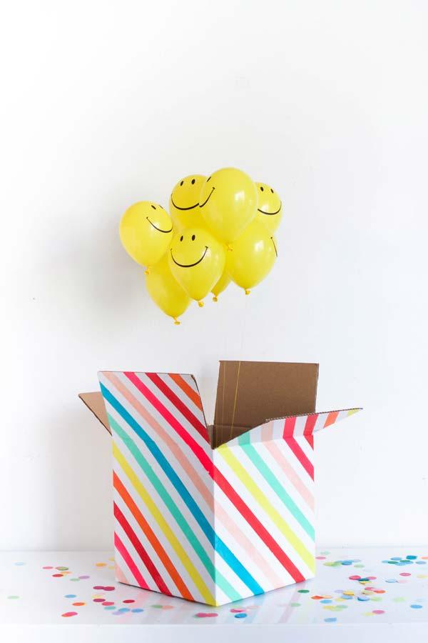 De dentro da caixa, um ramalhete de smiles