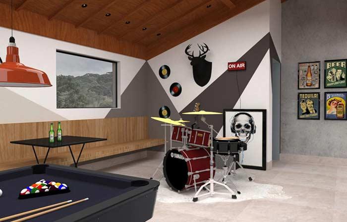 Com estúdio musical e bateria