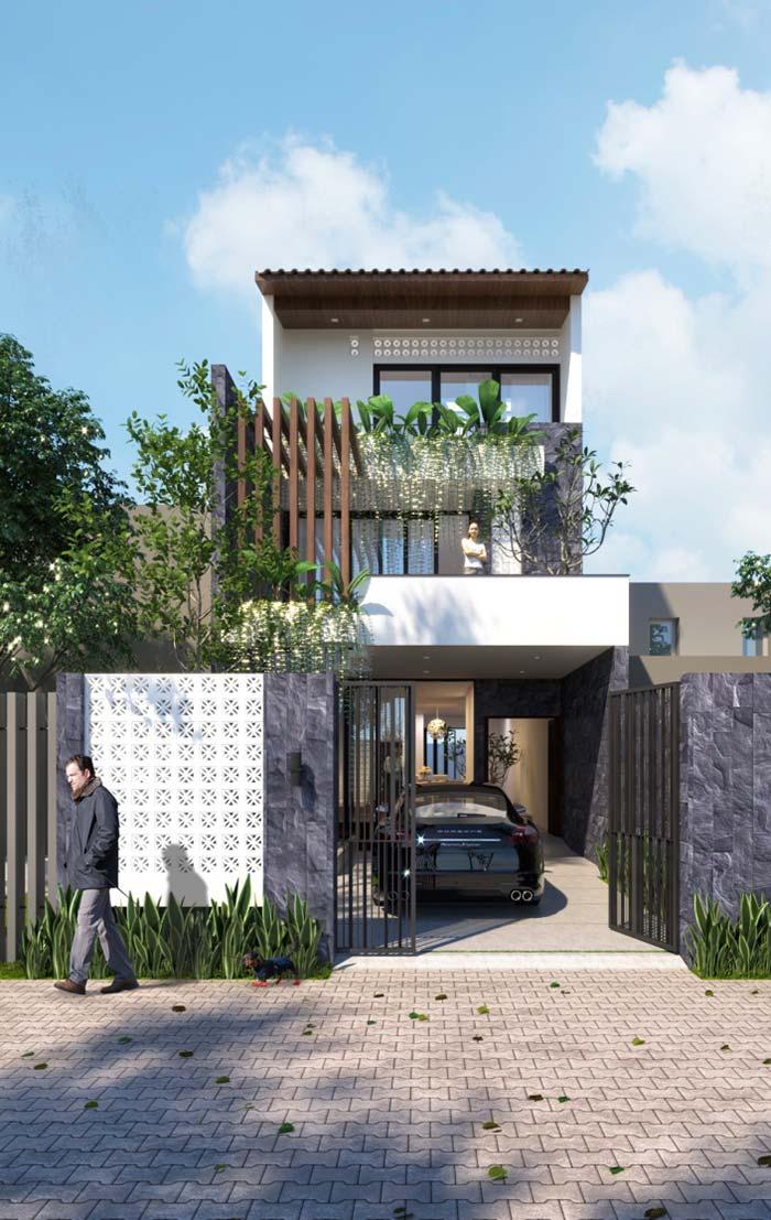 Casa branca em combinação com o cinza das pedras