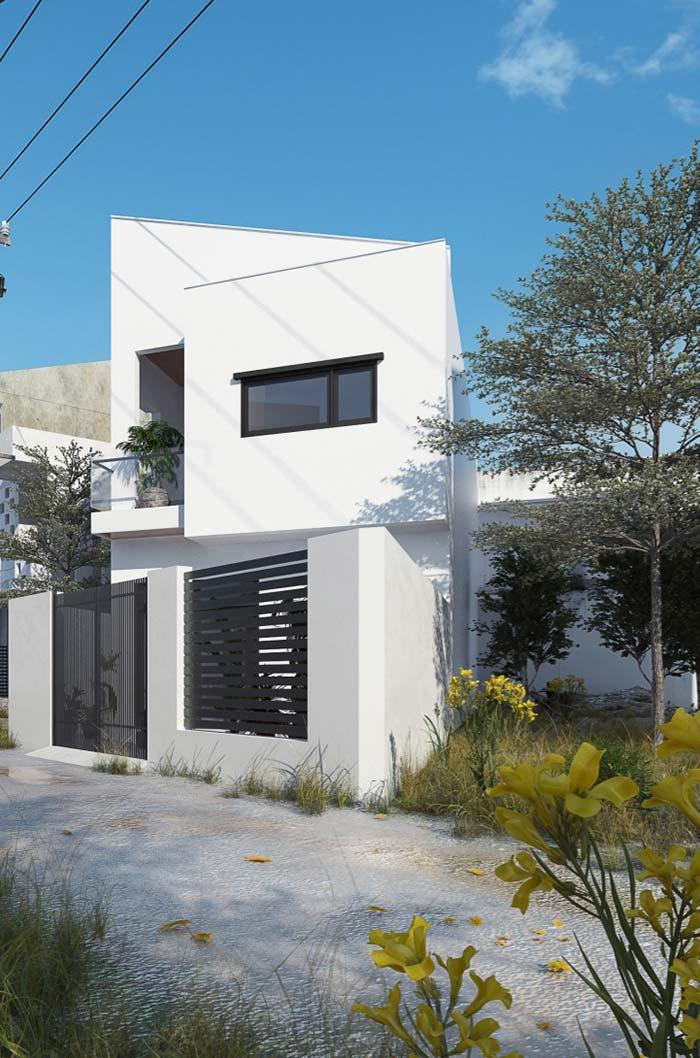 Detalhes pretos conferem modernidade à casa pintada de branco
