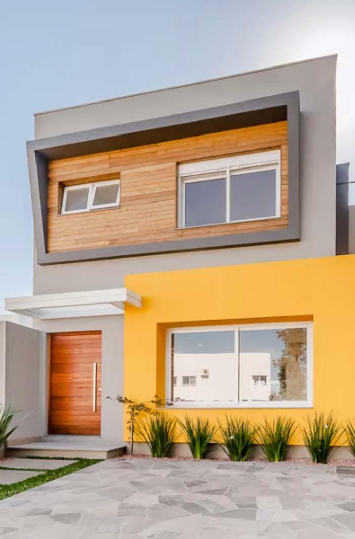 Cores de casas: amarelo vibrante no muro, no restante da casa a sobriedade impera