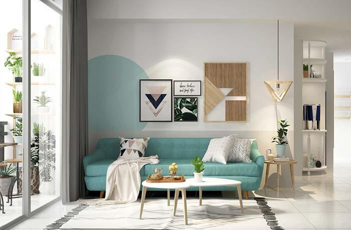 Sala de estar branca com elementos decorativos em azul turquesa