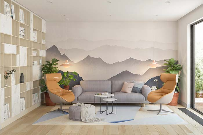 Sala de estar decorada com painel de montanhas
