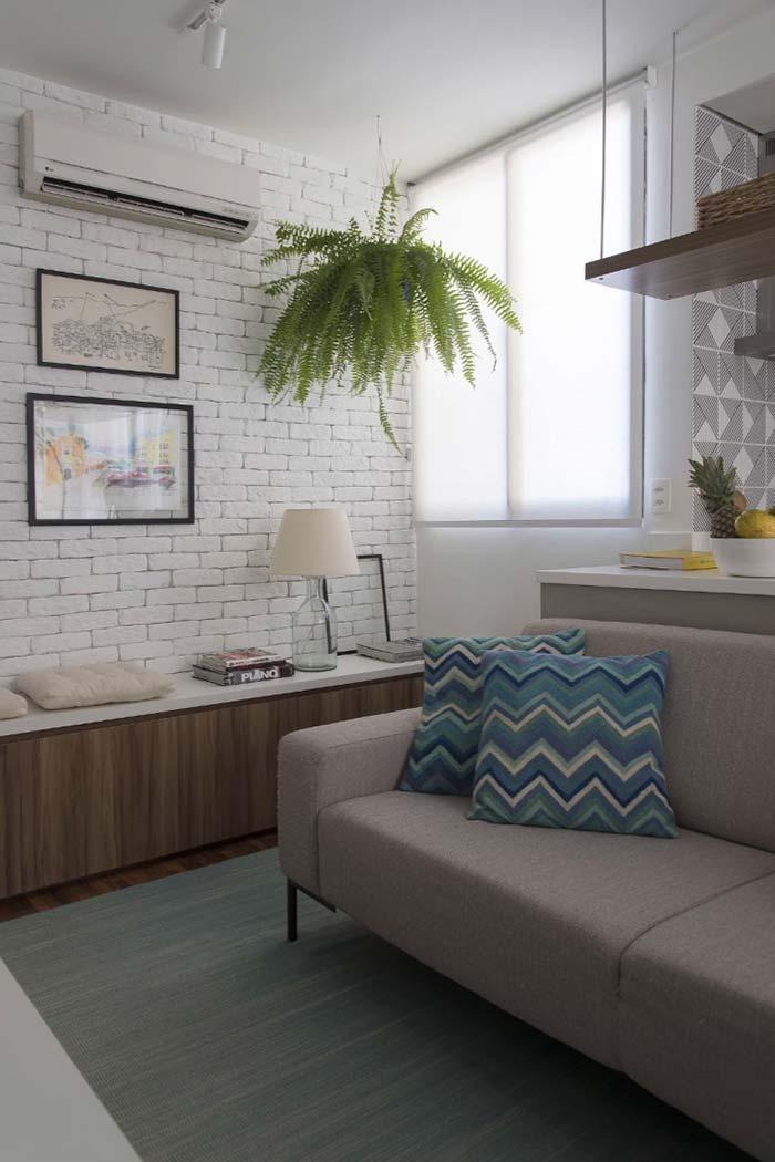 Sala de estar com parede de tijolinho
