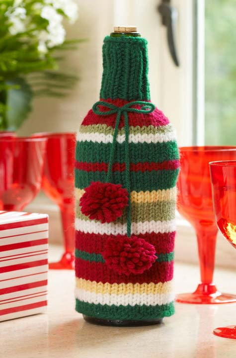 Garrafa decorada com um suéter de lã