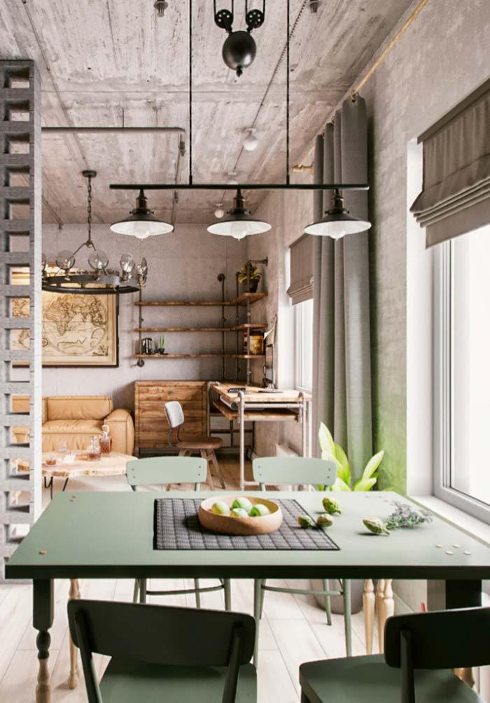 Mesa verde, de tom pastel, realça a decoração de estilo industrial