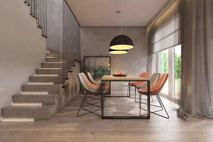 Lustre baixo cria uma iluminação intimista para sala de jantar