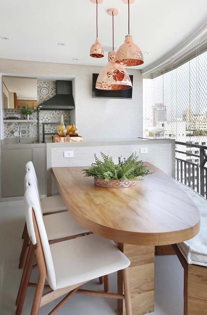 Varanda gourmet com mesa planejada
