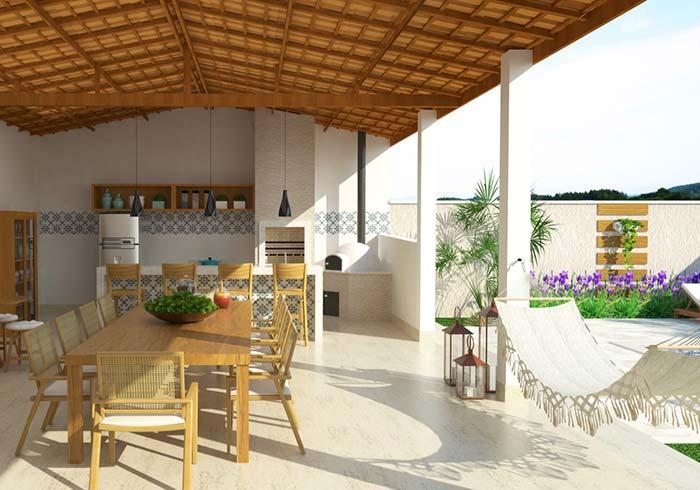 a varanda gourmet agrega a área descoberta do quintal e ganha ainda mais espaço