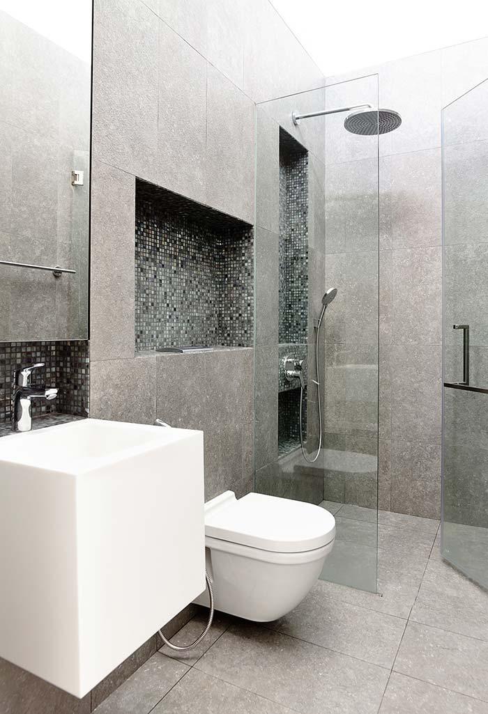 Banheiro modernos com muito cinza, vidro e formas retas