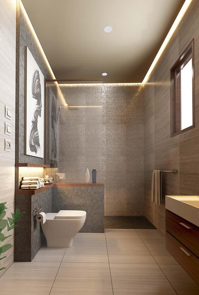 banheiro moderno decorado com quadro