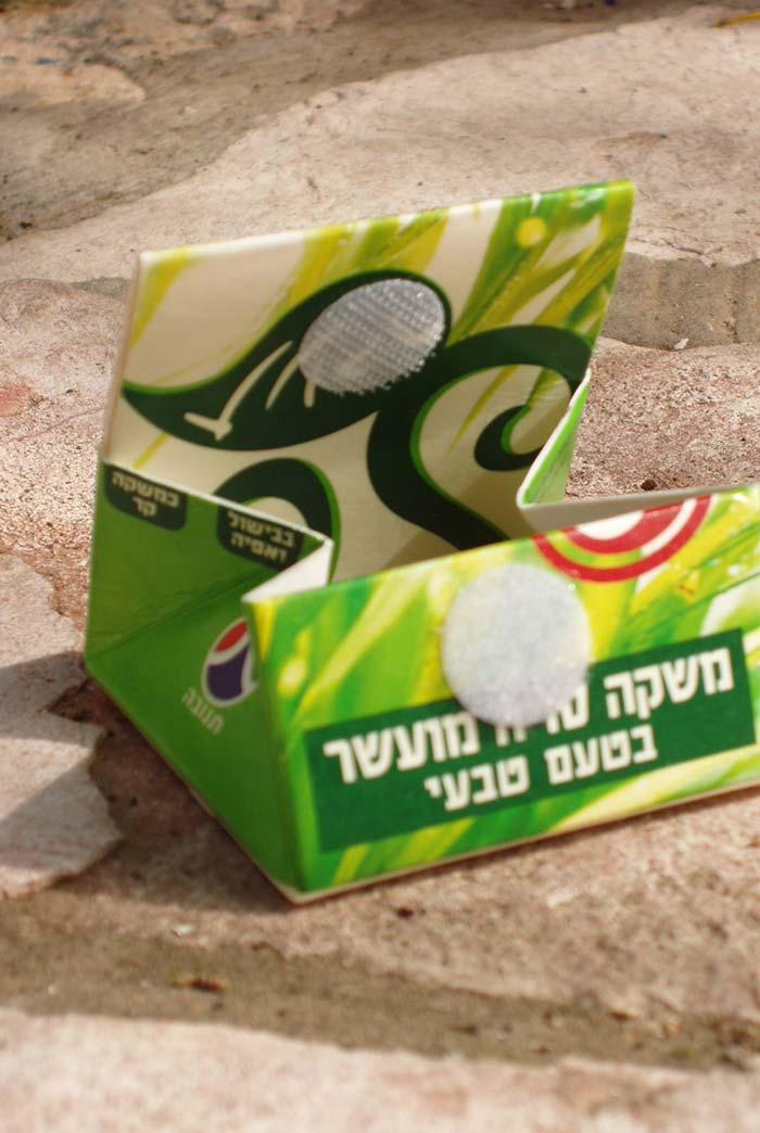 Caixa de leite que vira carterinha