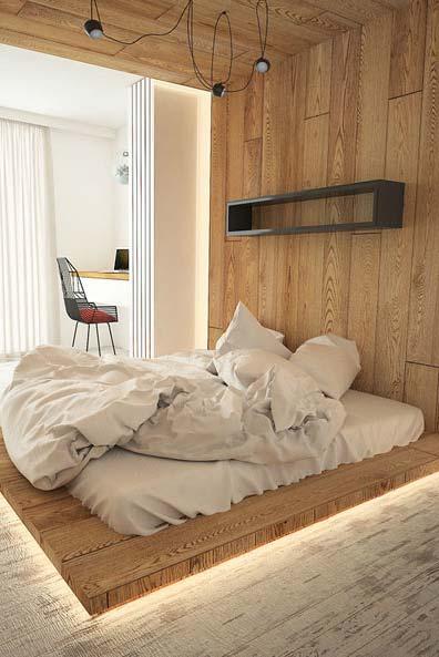 Dê aquele clima no quarto, instalando iluminação na base da cama.