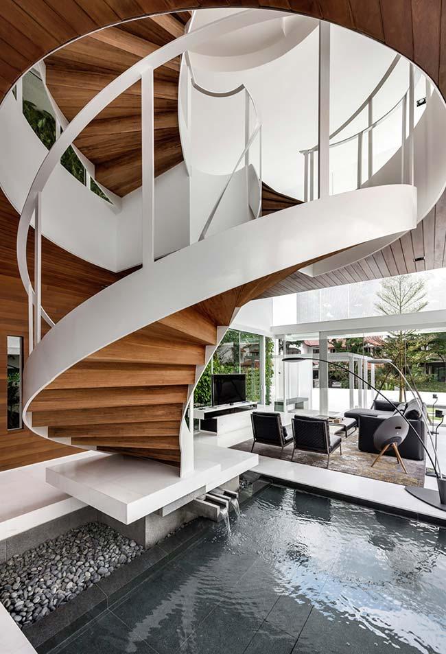 Outra escada caracol que ganha o protagonismo neste ambiente contemporâneo