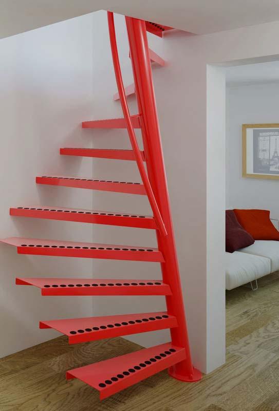 escada caracol de metal em vermelho com detalhe para os adesivos redondos antiderrapantes