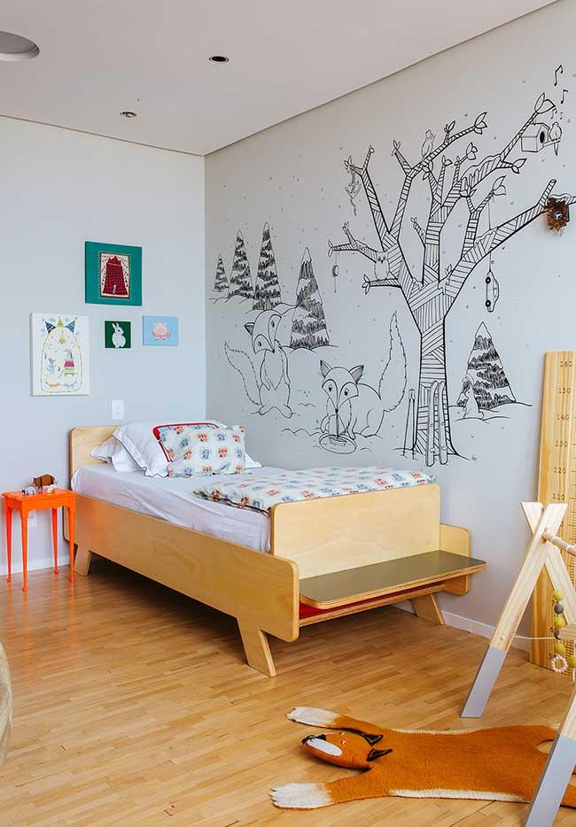 Quarto de menino com desenho pintado na parede