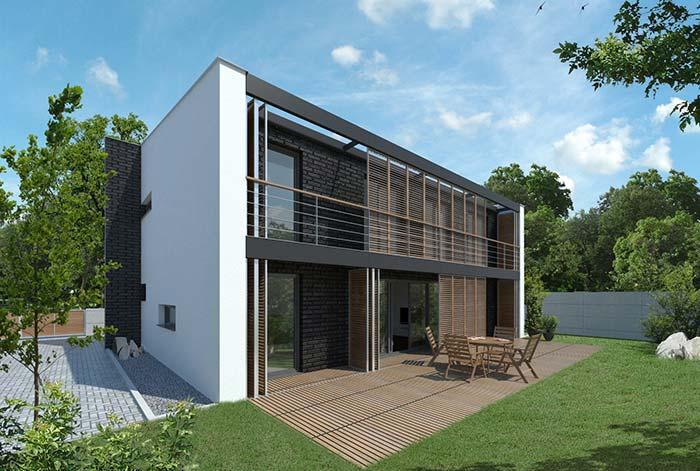 Platibanda segue nas laterais da casa com o intuito de esconder o telhado, assim como na frente da construção