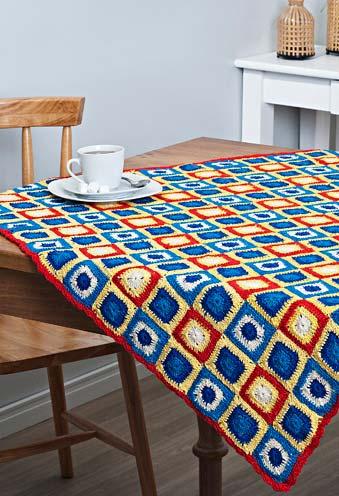 Toalha de mesa com quadrinhos coloridos