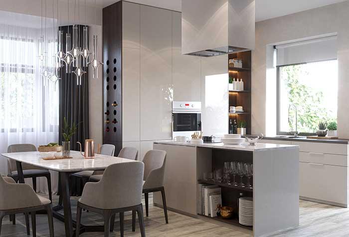 Nesse projeto, a ilha, entre outras funções, ajuda a delimitar a área entre a cozinha e a sala de jantar
