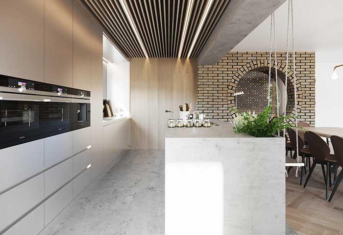 Cozinha com ilha para a varanda gourmet