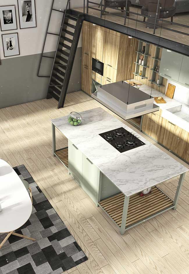 Ilha de cozinha grande e espaçosa abriga cooktop e armário