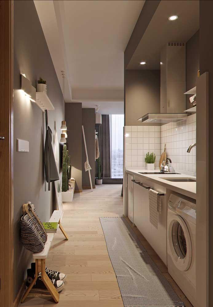Cozinha e lavanderia em um espaço milimetricamente planejado