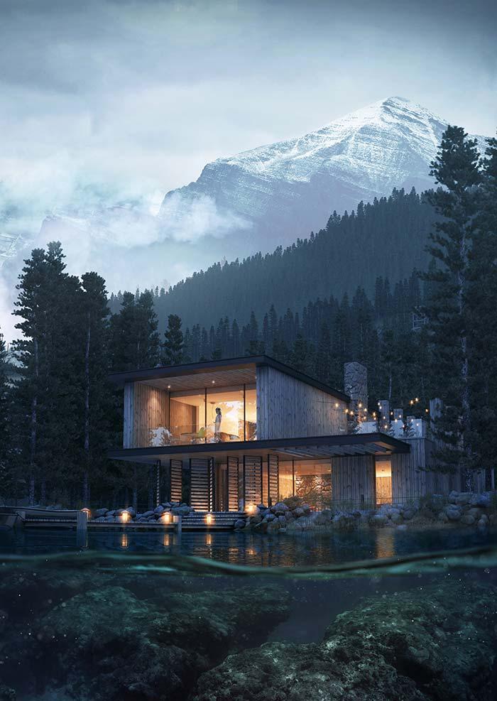 Em meio à natureza, essa fachada de casa se destaca pelo uso da madeira em todas as paredes externas