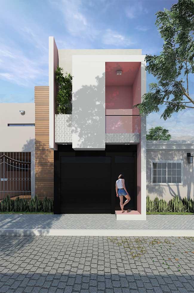 Delicada e levemente romântica: essa fachada de casa que mescla o rosa suave com o branco conta ainda com tijolinhos aparentes posicionados na vertical