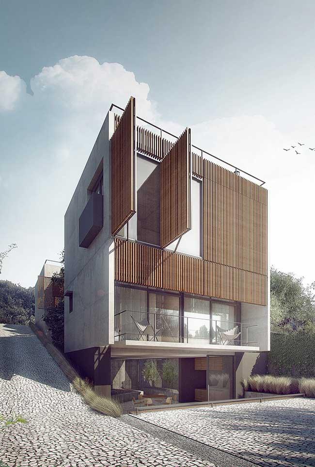 O concreto aparente também é a base dessa proposta de fachada; junto com ele, a madeira e o vidro