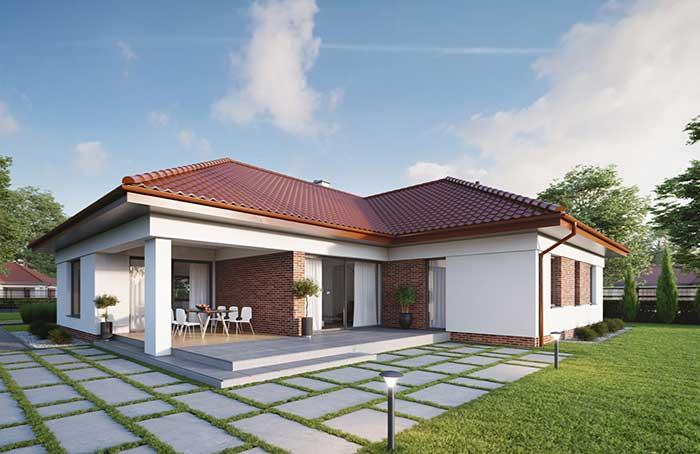 A casa pequena apostou no tom avermelhado das telhas e dos tijolinhos para se destacar