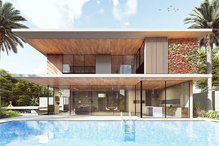 Uma fachada clean e de traços suaves valorizada ainda mais pelo uso do vidro