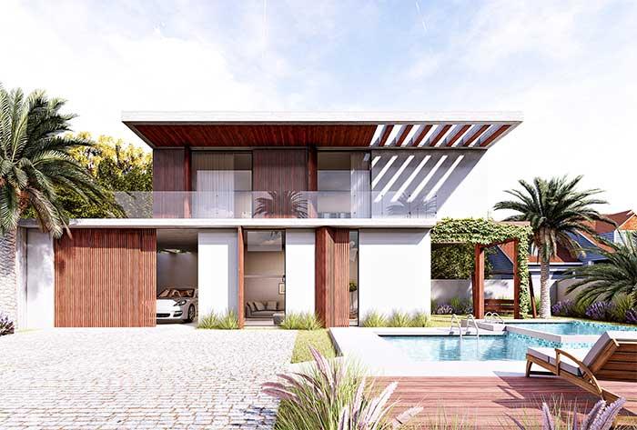 A estrutura vazada no telhado dessa casa traz luminosidade extra para a varanda