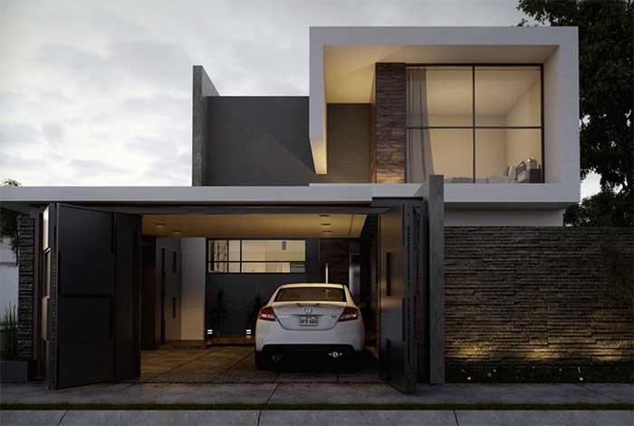 Fachada de casa: os tons terrosos da madeira e das pedras fazem uma combinação interessante com o cinza da parede