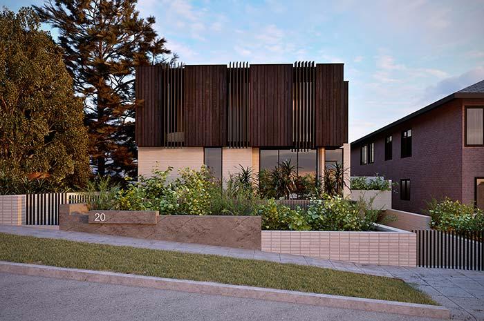 Se não puder ir de árvores, vá de canteiros ou pequenos jardins para complementar a fachada