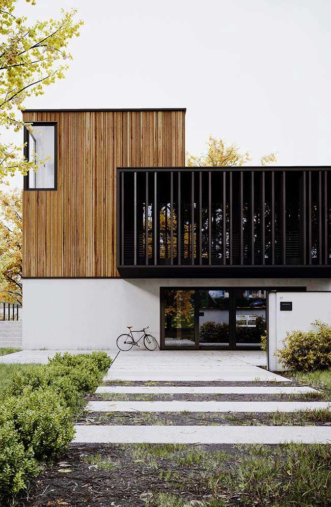 Unindo o rústico ao moderno: nessa fachada de casa, a proposta é essa