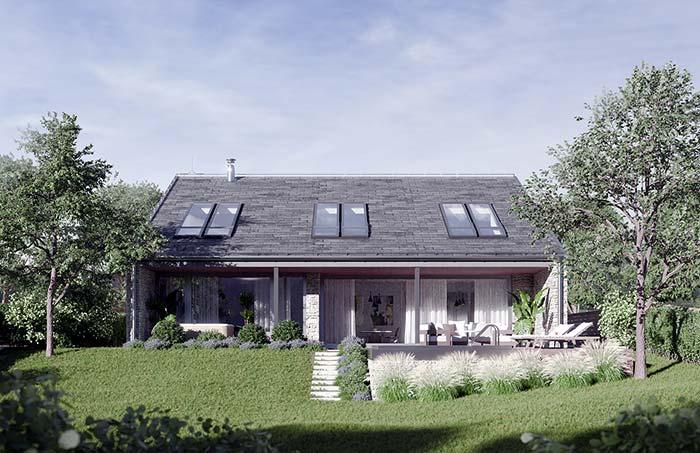 Casa simples e pequena destaca em sua fachada as janelas no telhado