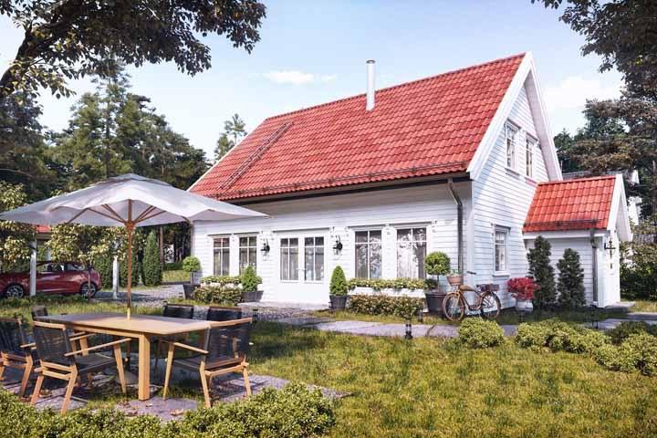 Um clássico modelo de casa de madeira: branca e com telhado vermelho