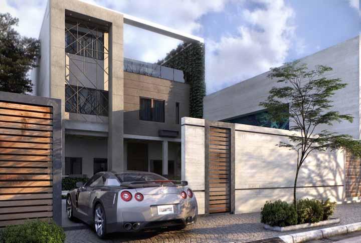 Nessa casa moderna, o muro verde se destaca