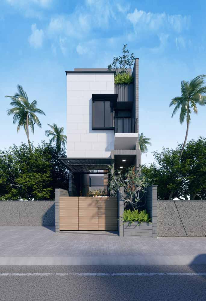 Casa moderna apostou na combinação de tons neutros – cinza e branco – para a fachada; as plantas completam o visual