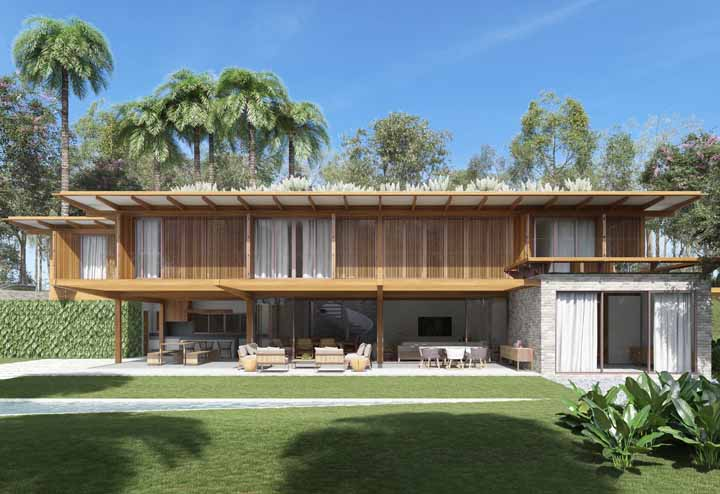 Já essa casa de campo manteve as características que tornam esse tipo de residência puro conforto: a madeira