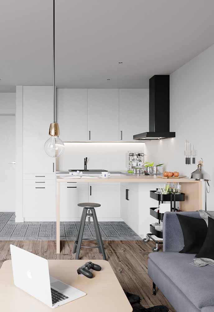 Cozinha simples para ambientes conjugados: separação dos espaços pela bancada-mesa