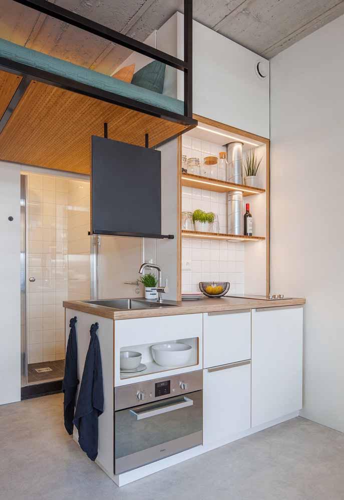 Este ambiente mostra que não precisamos de muito espaço para uma cozinha simples e funcional