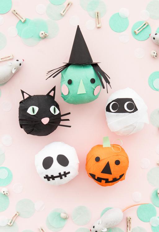 Use balões para fazer outros personagens não-tão-assustadores: gatinho, bruxa, múmia, abóbora e fantasma decorados com papel colorido