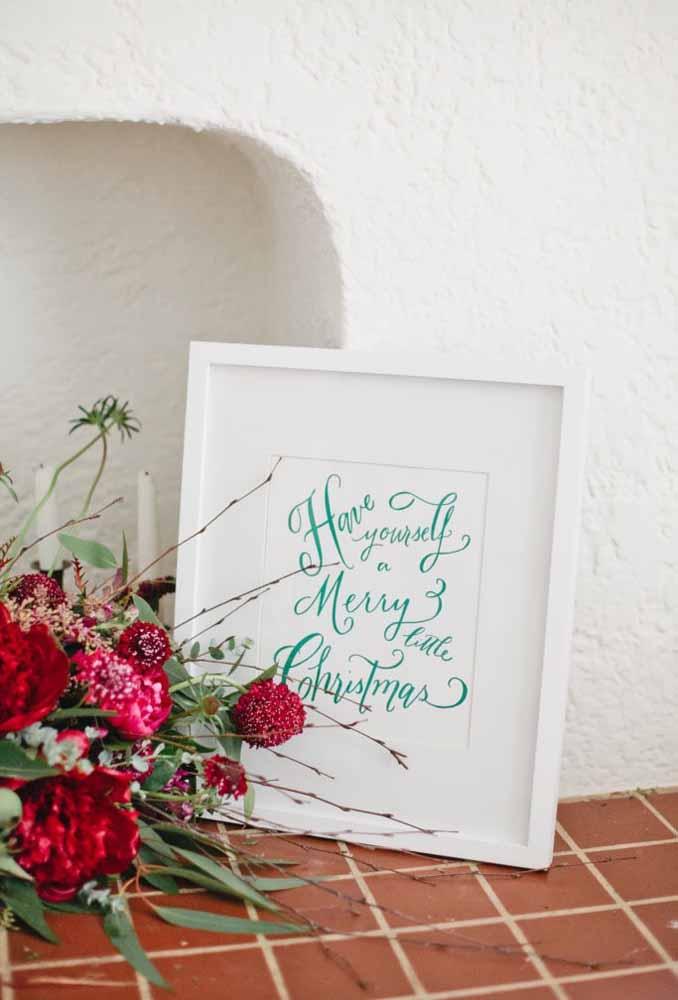Mensagem de natal gravado em um quadro