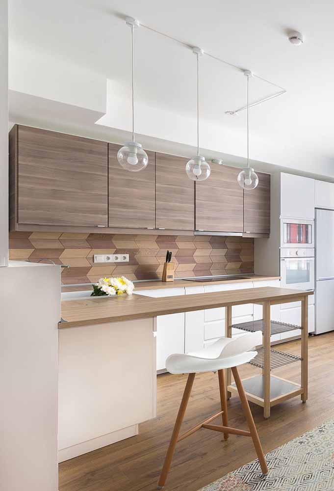 cozinha pequena planejada: utilize de ilha para otimizar os espaços e unificar ambientes
