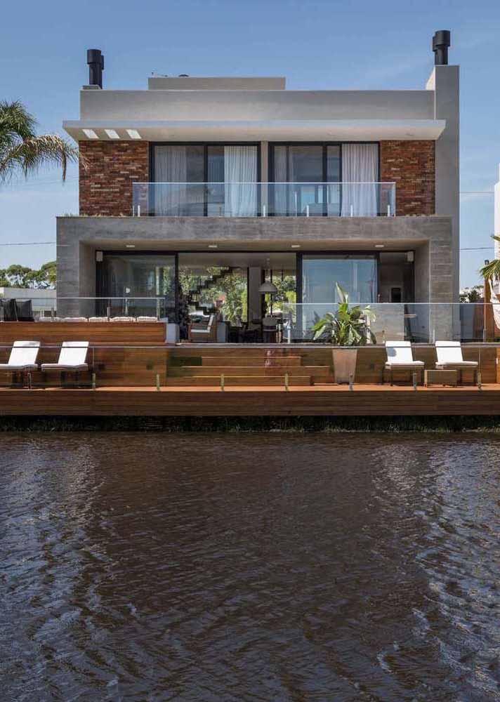 E essa encantadora casa na beira do lago é um projeto do escritório Martin Arquitetura