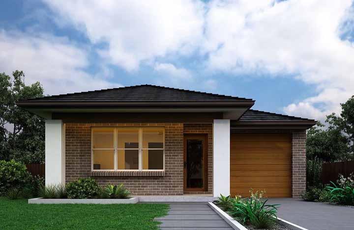 A fachada de tijolinhos criada pelo escritório Better Built Homes apostou no uso da madeira como elemento secundário