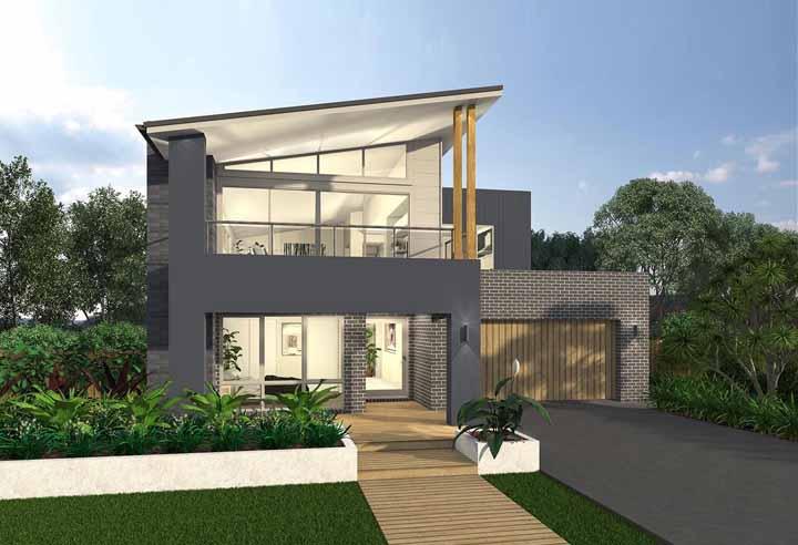 A fachada dessa casa projetada pelo escritório McDonald Jones apostou no uso do vidro para alcançar um visual clean e moderno