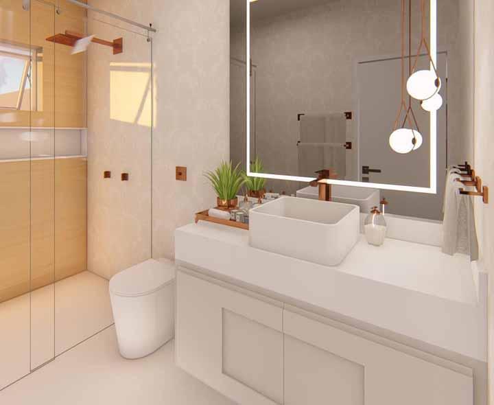 Traga um elemento tendência para a decoração do banheiro, mesmo que ele seja simples; aqui, por exemplo foi o rosé gold que ganhou destaque